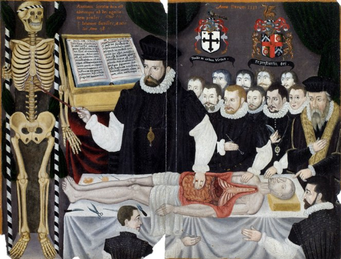 Painting shows a man pointing at a skeleton, and also demonstrating the post-mortem of a corpse, which has been opened up and has internal organs on display.  A number of men are watching.