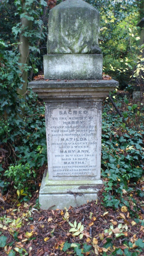 "The grave of four children, none over the age of 4, all lost to the same family between 1849 and 1852.  ""Deeply regretted"" is a common phrase on Victorian graves, particularly the graves of those who died young."