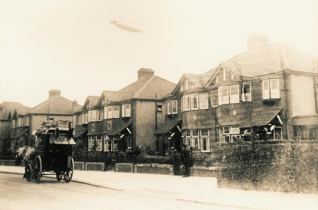 Image from an old postcard showing the English R101 airship over Burnley Road, London c. June 1930 (image from Wikimedia Commons)