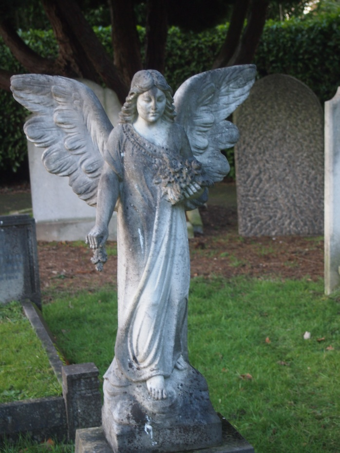 Another angel at East Sheen, marking the grave of an Iraqi-born couple