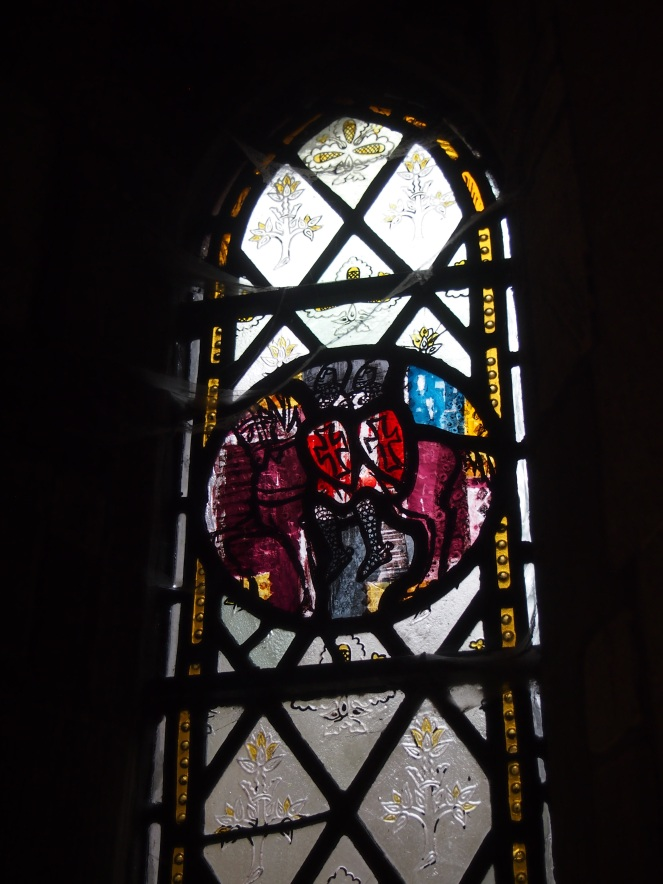 This window depicts two knights riding the same horse, one of the symbols of the Knights Templar