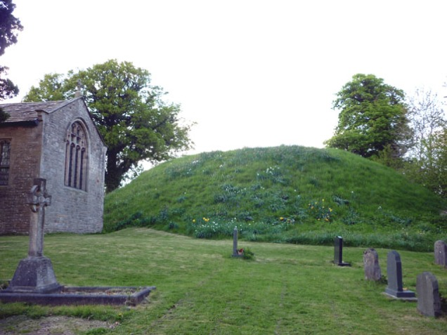 The motte behind St John the Baptist, Arkholme (image by [] via Wikimedia Commons)