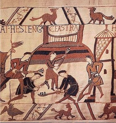 Scene from the Bayeux Tapestry depicting the building of a motte (image from Wikimedia Commons)