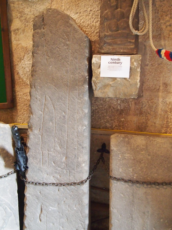 Carved blades on a medieval tombstone