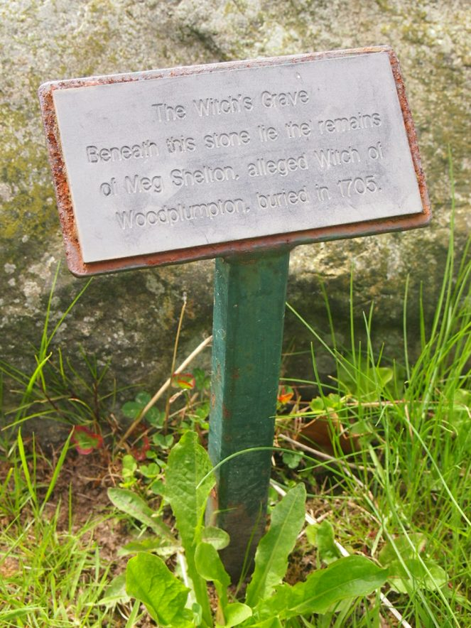 A little plaque explains that the boulder covers Meg's grave
