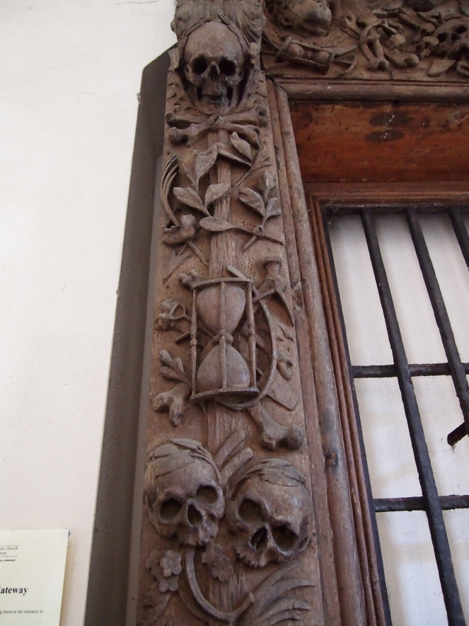 Some of the memento mori carvings on the wooden gate that once stood outside All Hallows Lombard Street