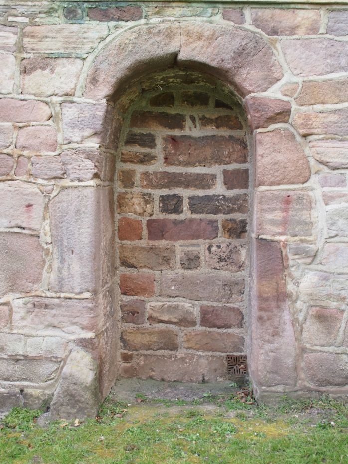 Blocked-up Anglo-Saxon doorway at St Peter's Church