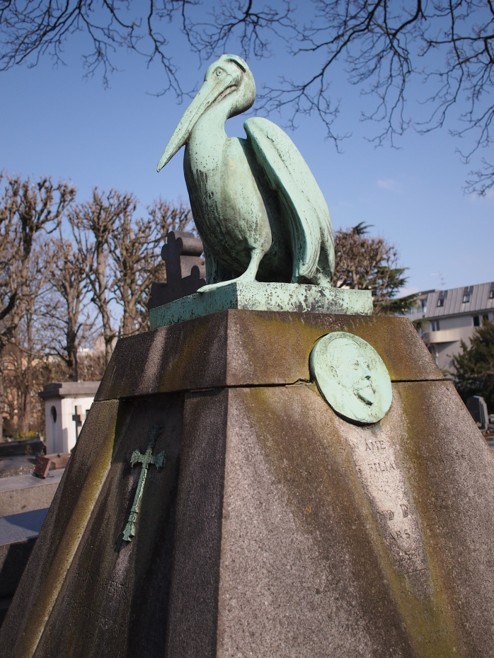 Unusual grave topped with a pelican, a symbol of devotion and piety