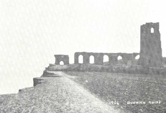 1904 postcard showing the ruins of the church of All Saints on the cliff edge (image via Wikimedia Commons)